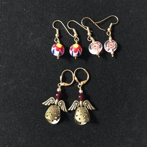 3 sets of red earrings with angels